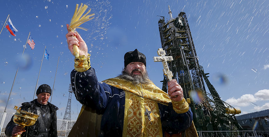 An Orthodox priest conducts a blessing in front of the Soyuz TMA-20M for the next International Space Station (ISS) crew at the Baikonur cosmodrome, Kazakhstan, March, 2016