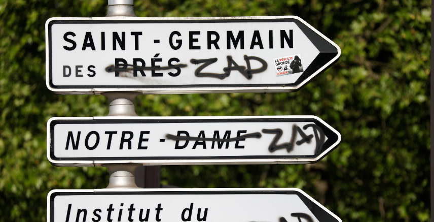 Road signs with graffiti reading ZAD (Deferred Development Zone) is seen after clashes at the May Day labour union march in Paris, France, May 2, 2018. REUTERS/Charles Platiau
