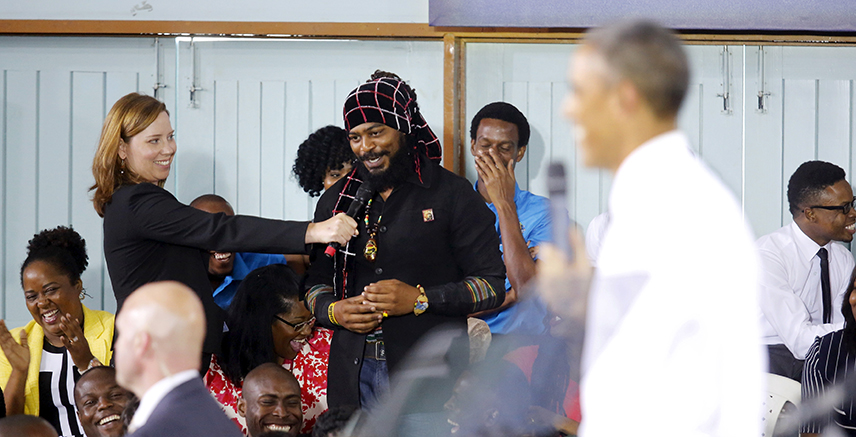 A man asks a question about the legalization of marijuana as U.S. President Barack Obama (R) holds a town hall meeting with young Caribbean leaders at the University of the West Indies in Kingston, Jamaica April 9, 2015.