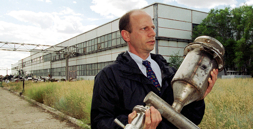 Andrew Weber, U.S. Pentagon expert, carries a part of equipment at the former Soviet bio weapons facility in northern Kazakhstan's town of Stepnogorsk in this July 25, 2000 file photo.
